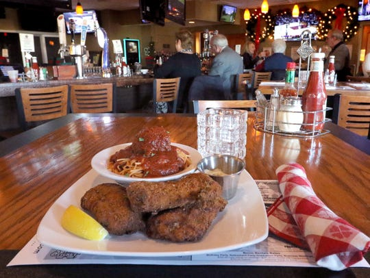 Fish Fry served with pasta and a meatball at Albanese's