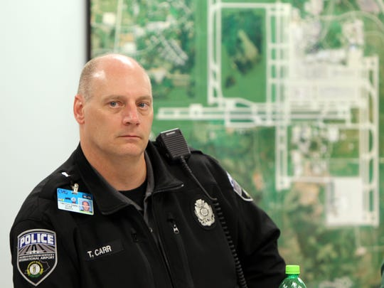 Cincinnati/Northern Kentucky International Airport Police Cpl. Timothy Carr listens during a naloxone demonstration. Police are now permitted to use the drug when responding to overdoses.