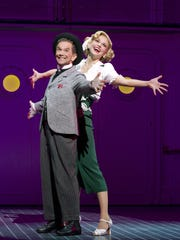 """In this theater publicity image released by Boneau/Bryan-Brown, Joel Grey, left, and Sutton Foster are shown during a performance of """"Anything Goes,"""" in New York. The Roundabout Theatre Company revival of the Cole Porter show, starring Sutton Foster and Joel Grey, was originally to close at the end of last July, but was extended until January. Now it'll be open until April 29 at the Stephen Sondheim Theater on 43rd Street. (AP Photo/Boneau/Bryan-Brown, Joan Marcus)"""