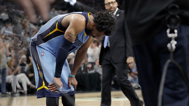 Memphis Grizzlies guard Mike Conley (11) hangs his head during a timeout in the second half in Game 2 against the San Antonio Spurs, Monday, April 17, 2017, in San Antonio. San Antonio won 96-82.