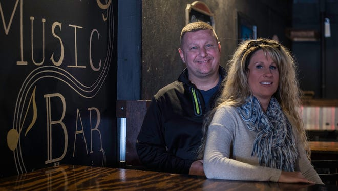 Terry and Cathy Hillard pose for a photo inside Bertie's Music Bar on Wednesday, Dec. 27, 2017.