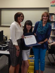 Sublimity School Student Body Vice-President Mya Joyce (center) receives a Student Board award from School Principal Missy Riesterer (left) and board member Laura Wipper.