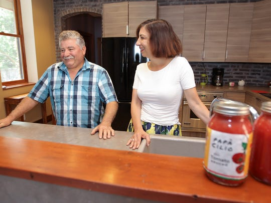 Papa Cilio, left, and Audrey Cassuro in the kitchen at Casa Hudson in Haverstraw.  Friday, July 21, 2017.  Casa Hudson holds cooking classes where they use fresh home grown tomatoes to make tomato sauce.