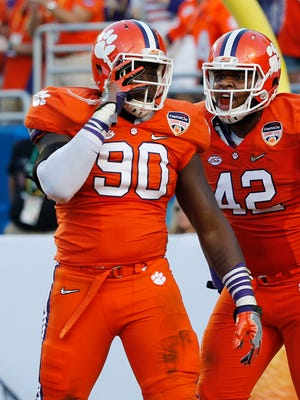 Shaq Lawson (90) and teammate Christian Wilkins celebrate a sack Thursday against Oklahoma in the Orange Bowl semifinal.
