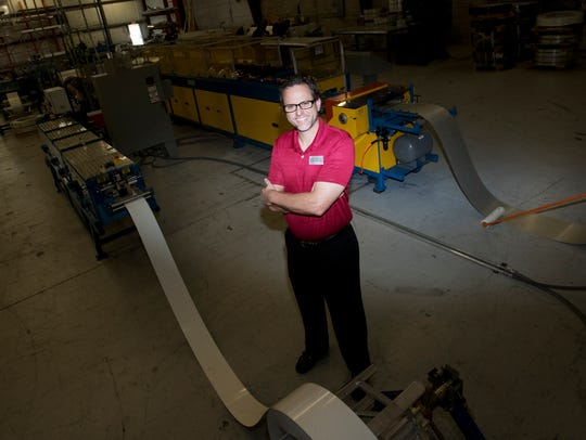 """Jeff Bonk, the president of Architectural Metal Flashings in Cape Coral, at his business on Tuesday. His business was recognized along with others at Catch the Vision, an event billed as a """"real estate look forward."""""""
