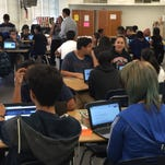 Students in an English/geography class in Irvin High School's New Tech Network program discuss possible catastrophes for a project on how natural and unnatural disasters affect human migration.