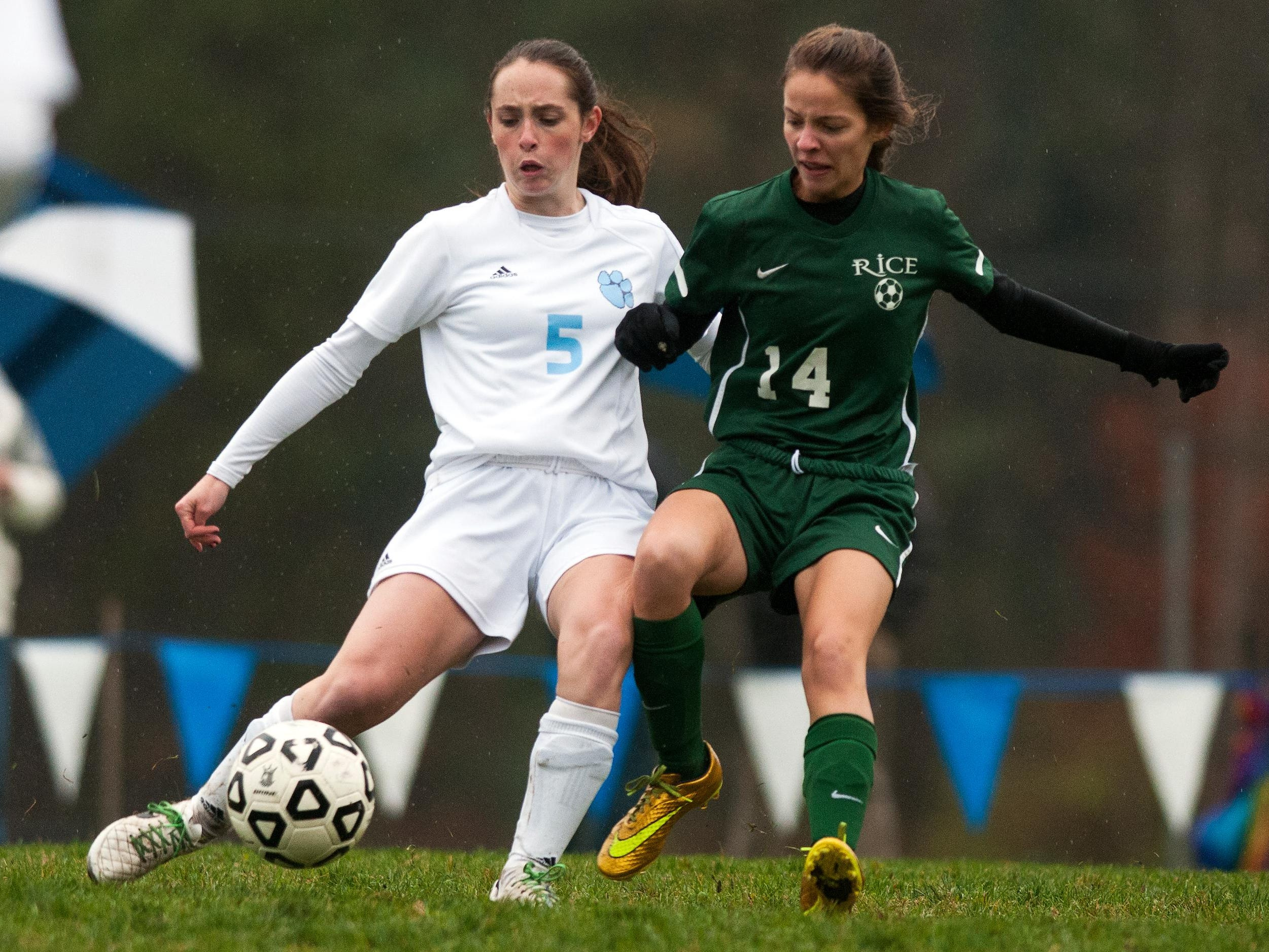 MMU's Molly Finn (5) and Rice's Katrina Garrow (14) battle for the ball during the girls soccer playoff game between the Rice Green Knights and the Mount Mansfield Cougars in 2014.