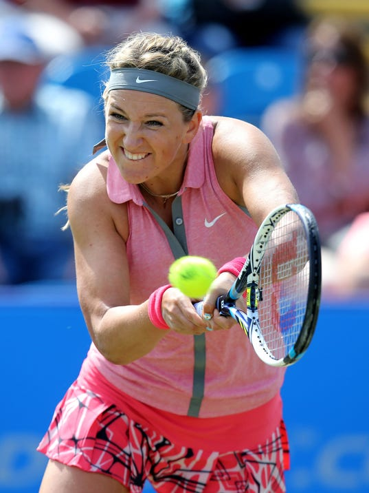 Victoria Azarenka from Belarus returns to Italy's Camila Giorgi  during the Aegon International at Devonshire Park, Eastbourne. England  Tuesday June 17, 2014. Giorgi won the match (AP Photo/John Walton/PA) UNITED KINGDOM OUT
