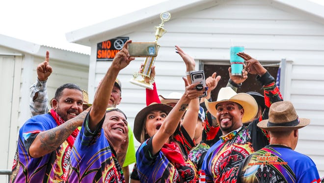 Members of the Southwest All Terrain Club celebrate with their first place trophy after winning best float in the parade. 2018 Lehigh Spring Fest was fun for the whole family who didn't mind a little rain Saturday afternoon. Families braved the rain to ride a few rides, enjoy each other's company, and watch some of the performances and activities. the 2018 Lehigh Spring Fest Parade was earlier in the morning.