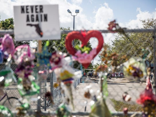 Students and parents begin to enter Marjory Stoneman