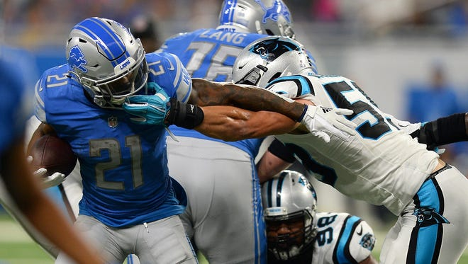 Oct. 8, 2017: Panthers linebacker Luke Kuechly is flagged for grabbing the face mask of Lions running back Ameer Abdullah in the first half at Ford Field. The Lions lost, 27-24.