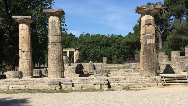 These are ruins of the Temple of Zeus, the Greek god who inspired the  Olympic Games in the 8th century B.C. in Ancient Olympia, Greece.