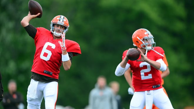 Cleveland Browns quarterback Brian Hoyer (6) and Johnny Manziel (2) throw passes during training camp at Cleveland Browns training facility.