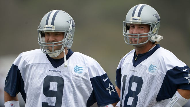 Dallas Cowboys quarterbacks Tony Romo (9) and Kyle Orton (18) at training camp at the River Ridge Fields.