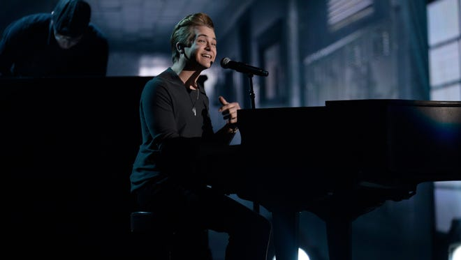 """Hunter Hayes performs """"Invisible""""  at the 56th Annual Grammy Awards at the Staples Center in Los Angeles, Calif."""