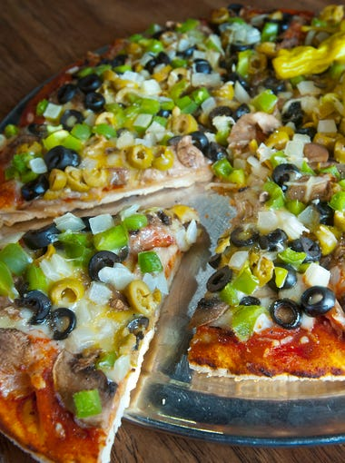 """Bonnie & Clyde's Pizzeria's """"vegetarian"""" is made with mushrooms, black olives, green olives, green peppers and onions, mozzarella provolone, Monterey Jack and Parmesan cheese (and a few pepperocini.) Feb. 21, 2018"""
