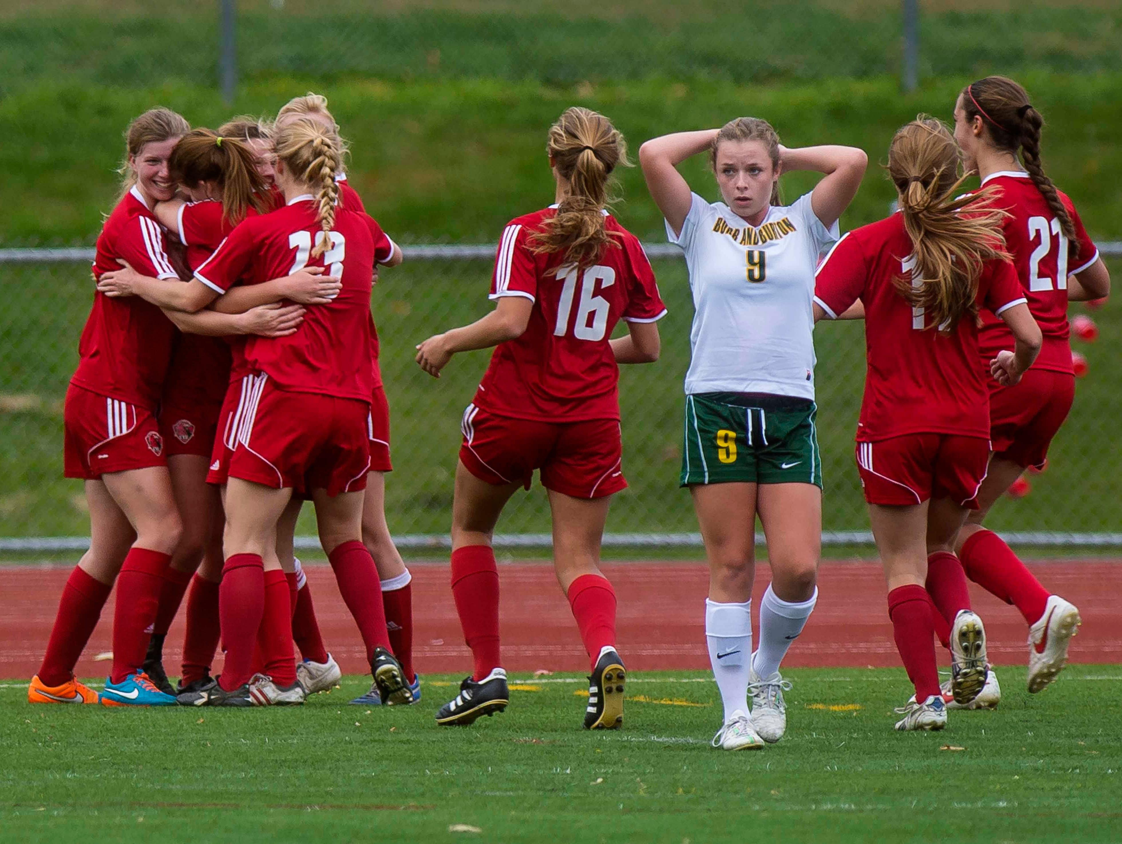 Burr & Burton's Una Langran walks away as CVU celebrates a goal in the Division I girls soccer championship in Burlington on Saturday, October 31, 2015.