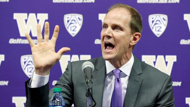 UW men's basketball coach Mike Hopkins answers questions at his introductory news conference Wednesday.