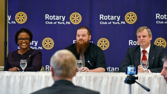 Kim Bracey, Dave Moser and Michael Helfrich are introduced during a York mayoral candidate debate hosted by the Rotary Club of York Wednesday, Nov. 1, 2017, at the Country Club of York. The three candidates — Democratic incumbent Kim Bracey, Republican candidate Michael Helfrich and Libertarian candidate Dave Moser — are running for mayor of York in the Nov. 7 election.