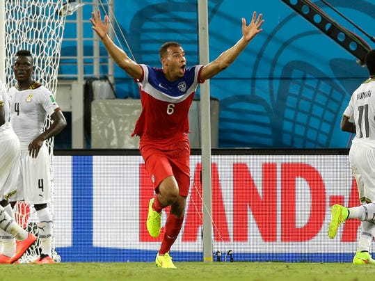 United States' John Brooks, centre, celebrates after scoring his side's second goal during the group G World Cup soccer match between Ghana and the United States at the Arena das Dunas in Natal, Brazil, Monday, June 16, 2014. The United States won the match 2-1. (AP Photo/Ricardo Mazalan)