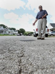 Tom Day talks about issues with Orange Street  near Piatt Avenue on Aug. 22.