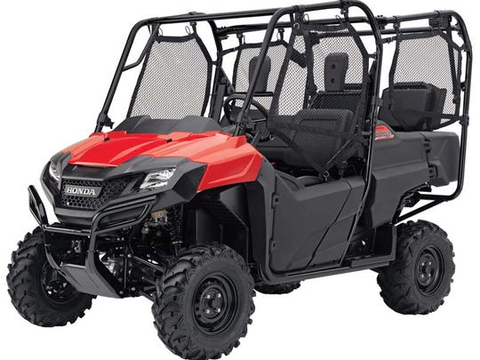 Vegetation and debris can accumulate on the middle skid plate of all models of the 2014 Honda Pioneer 700 recreational off-highway vehicle, making contact with the vehicle's exhaust system. Dried debris can ignite, resulting in smoke or fire.