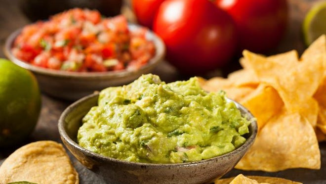 House-made guacamole with tortilla chips and salsa.