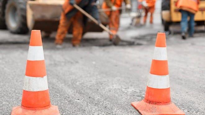 Workers repairing road.