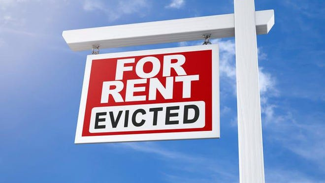 House or apartment for rent sign due to recent tenant eviction.