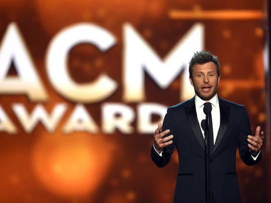 Co-host Dierks Bentley speaks onstage during the 51st