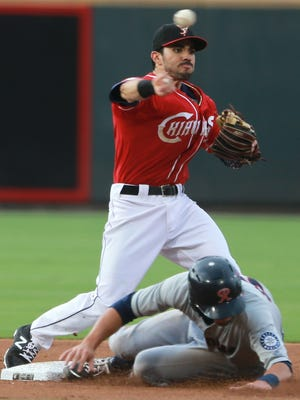 El Paso second baseman Carlos Asuaje throws over sliding Tacoma base runner Zach Shank to complete a double play Friday.