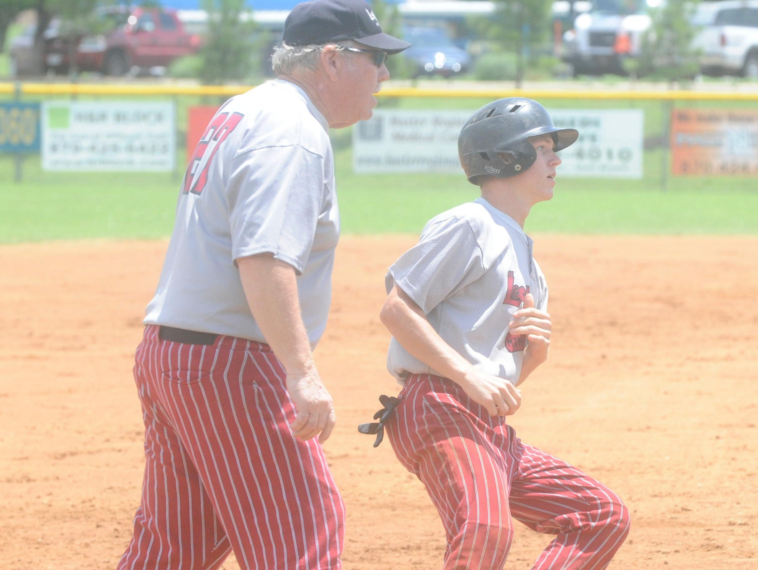 Mountain Home's Cody McCormack is held up at third base by Lockeroom head coach Lester White during a Twin Lakes Classic game earlier this season at Cooper Park.