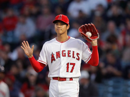 Los Angeles Angels starting pitcher Shohei Ohtani, of Japan, gestures while pitching against the Boston Red Sox during the first inning of a baseball game Tuesday, April 17, 2018, in Anaheim, Calif. (AP Photo/Jae C. Hong)