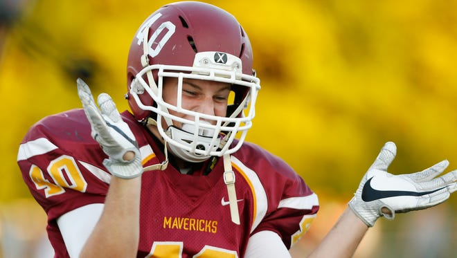 Walter Foster reacts after McCutcheon recovered a fumble by No. 10 Lafayette Jeff with 2:50 remaining in the first half Friday, September 2, 2016, in Lafayette. The Mavericks were up 21-3 at the time. The Mavericks went on to pound the Bronchos 45-3.