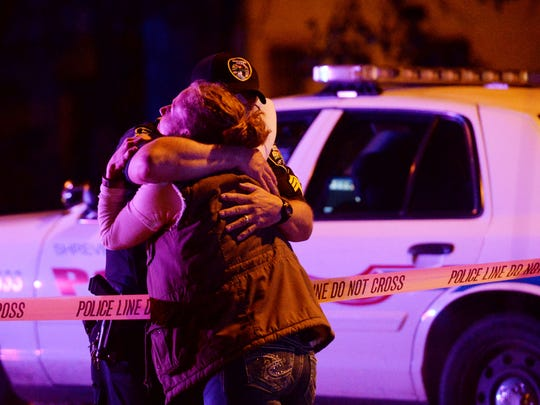 Officers embrace after a shooting on the campus of