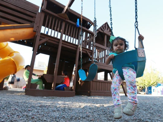 A child sat in a swing at La Posada Wednesday.