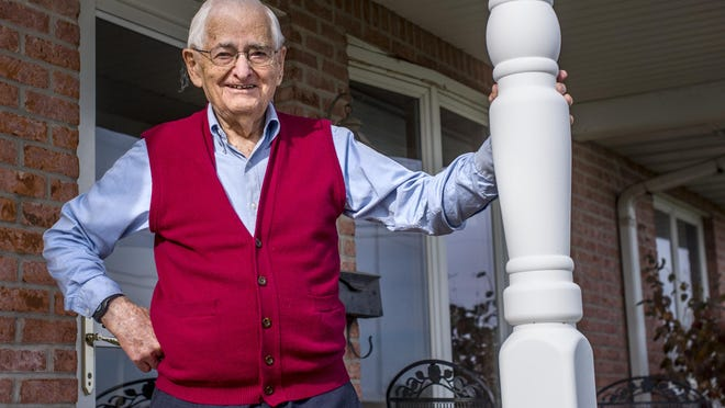 Cleo Koch stands on the front porch of his Tremont residence Monday, November 23, 2020.