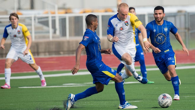 Rafters forward Steven Bush fights his way past a Fort Worth defender in a 4-2 win Sunday night.