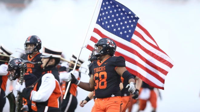 The Massillon Tigers take the field against St. Edward for last week's season opener.