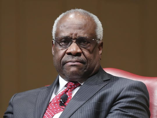 "FILE - In this Feb. 15, 2018, file photo, Supreme Court Associate Justice Clarence Thomas sits as he is introduced during an event at the Library of Congress in Washington. When Thomas arrived at the Supreme Court in the fall of 1991 after a bruising confirmation hearing in which his former employee Anita Hill accused him of sexual harassment, fellow justice Byron White said something that stuck with him. ""It doesn't matter how you got here. All that matters now is what you do here,"" Thomas recounted in his 2007 memoir, ""My Grandfather's Son.""(AP Photo/Pablo Martinez Monsivais, File)"