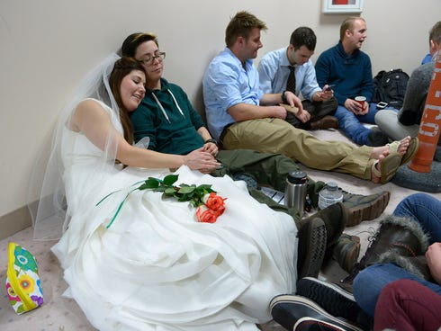 Heather, left, and Jax Collins of West Jordan, Utah, join hundreds of other same-sex couples descending on county clerk offices around the state of Utah on Dec. 22 to request marriage licenses. A federal judge allowed gay marriage to continue in Utah