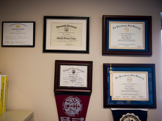 Diplomas and certificates hang on the wall in the office