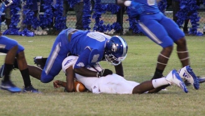 A Jefferson Davis County defender tackles a Natchez High ball carrier Friday.