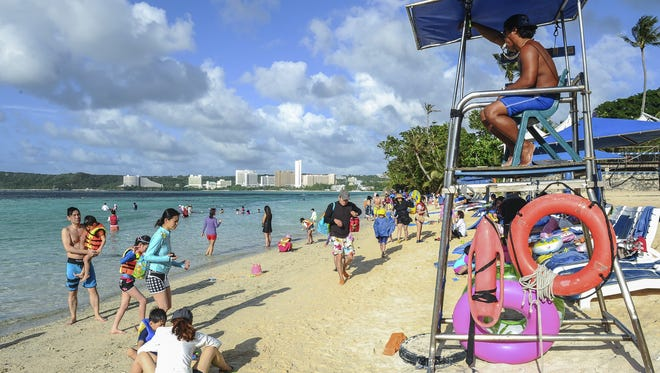 In this file photo, Peter Aguon sits in a lifeguard tower as he watches over swimmers enjoying the beach fronting the Pacific Island Club in Tumon.