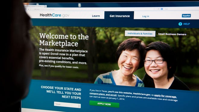 A woman looks at the HealthCare.gov insurance exchange site Oct. 1.