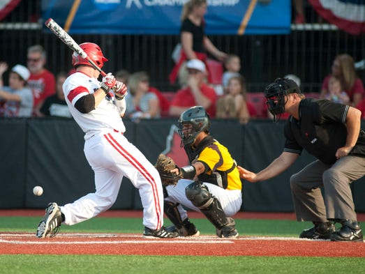Louisville Cardinals' Kyle Gibson is hit by a wild pitch in the bottom of the 3rd inning. He would eventually score on a single by Louisville Cardinals' designated hitter Nick Solak. 06 June 2014