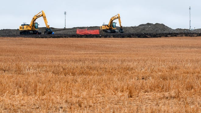 In this Oct. 11, 2013 file photo, cleanup continues at the site of an oil pipeline leak and spill north of Tioga, N.D. North Dakota, the nation's No. 2 oil producer behind Texas, recorded nearly 300 oil pipeline spills in less than two years, state documents show. None of them were reported to the public.