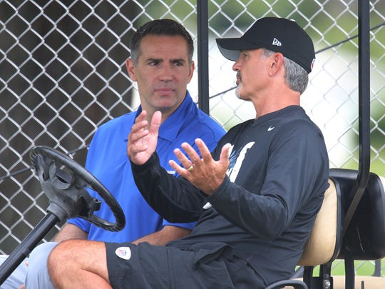 Former NFL QB Kurt Warner,left, talks with Indianapolis Colts head coach Chuck Pagano on the third day of Training Camp Saturday July 26, 2014, afternoon at Anderson University. Matt Kryger / The Star