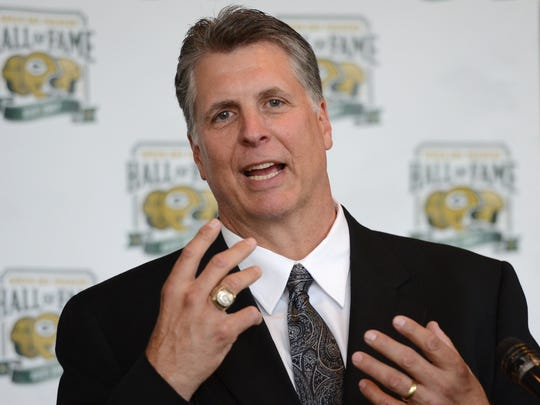 Ken Ruettgers speaks during a news conference before the Green Bay Packers Hall of Fame Induction Banquet at Lambeau Field.