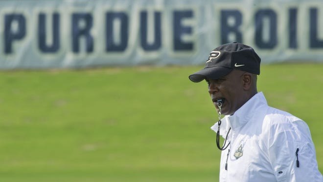 Purdue coach Darrell Hazell watches his team during the first day of practice Monday, August 4, 2014, at the Bimel Practice Complex